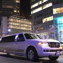 Lincoln Navigator Pearl White by Boss Limousine Service